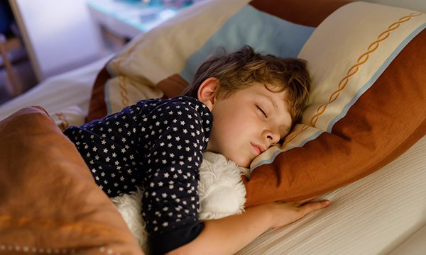 Picture shows a child sleeping. Scientists say a blood molecule could be used in a test to show if children get enough sleep or are susceptible to certain health conditions.