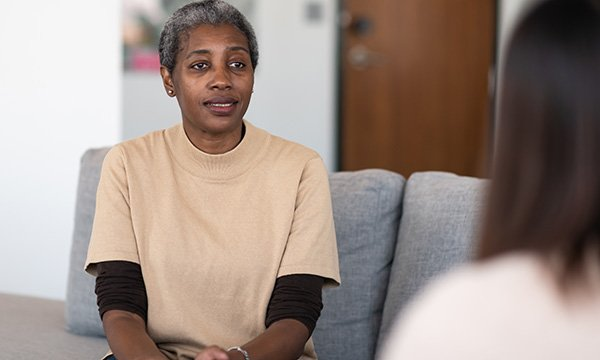 Picture shows an older woman talking to a therapist. A new study shows the wider lifestyle benefits associated with PBS-based approaches and the need to capitalise on these gains.