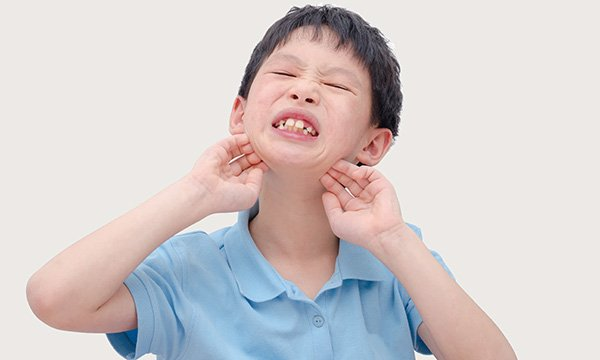 Picture shows a child scratching himself. Relying too much on observed stereotypical and repetitive behaviour may result in incorrect diagnosis of autism spectrum disorder in people with a learning disability and sensory impairments, a study suggests.