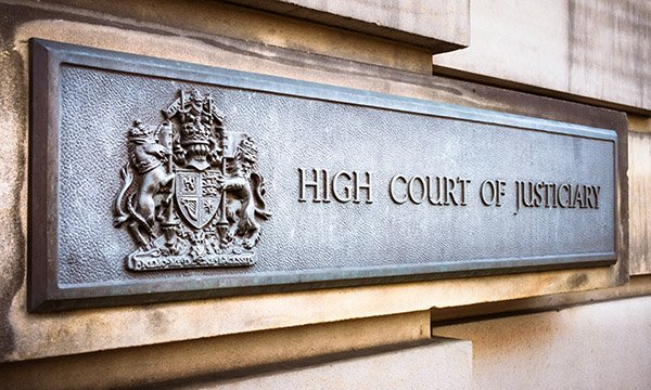 Sign outside High Court in Edinburgh, which reads 'High Court of Justiciary'