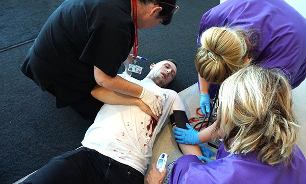 image of nursing students in a emergency care simulation scenario