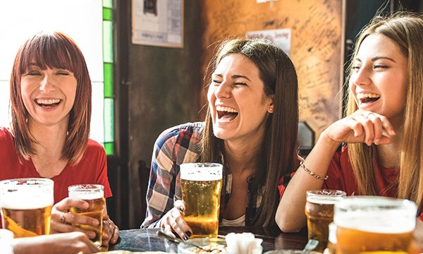 Stock image of off duty nurses socialising and drinking alcohol
