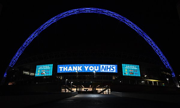 Wembley Stadium lit up blue