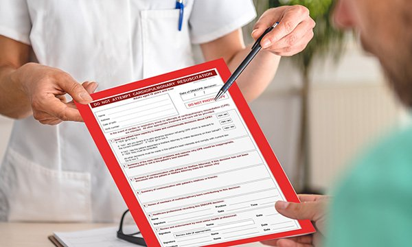 Picture of nurse with DNACPR form