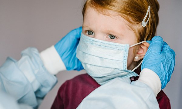 Picture of a child wearing a surgical mask