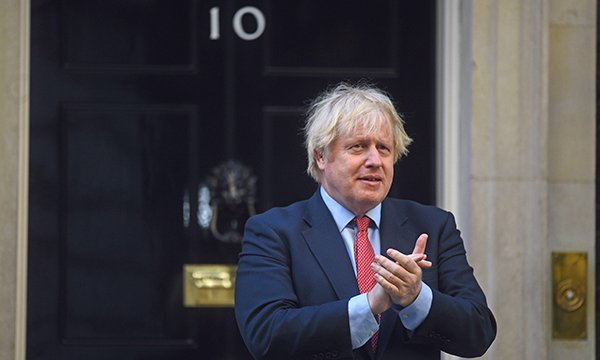 Prime minister Boris Johnson clapping outside No 10 Downing Street. Picture: Alamy
