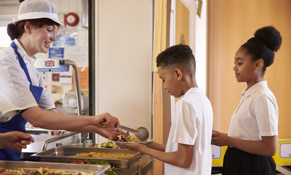 Picture shows children being served a school meal