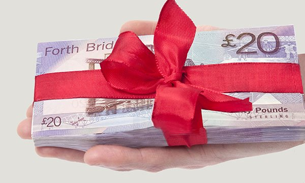 Picture shows a bundle of Scottish banknotes tied up in ribbon
