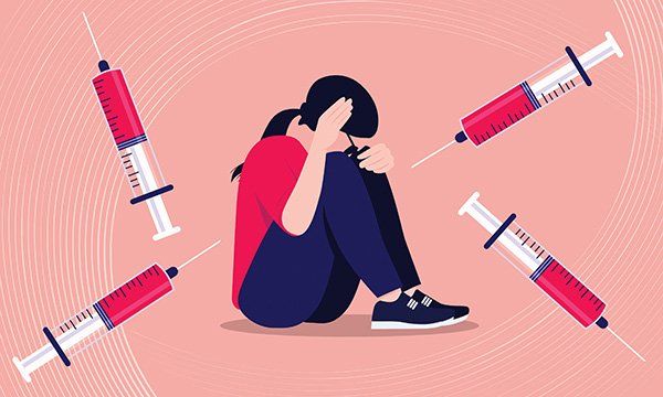 Illustration of a young woman with learning disabilities who is needle-phobic and afraid of being vaccinated