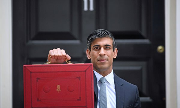 chancellor Rishi Sunak outside 11 Downing Street before heading to the Commons to deliver his budget