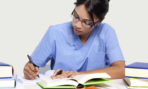 Nurse prepares paperwork for revalidation