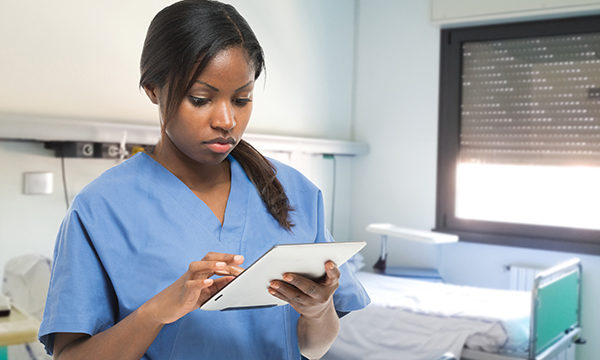 nurse consults tablet device