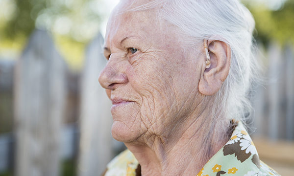 Older woman with a hearing aid