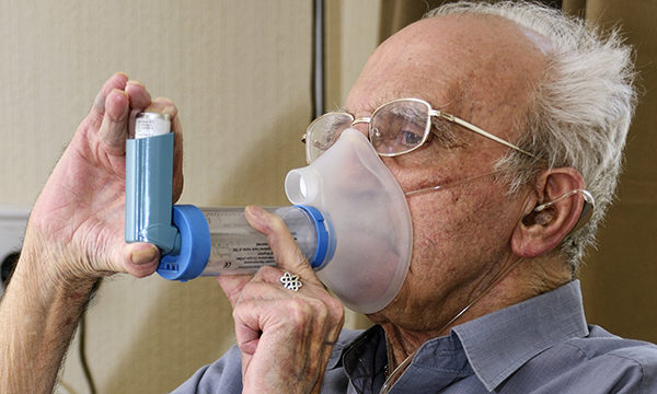 Man uses an inhaler