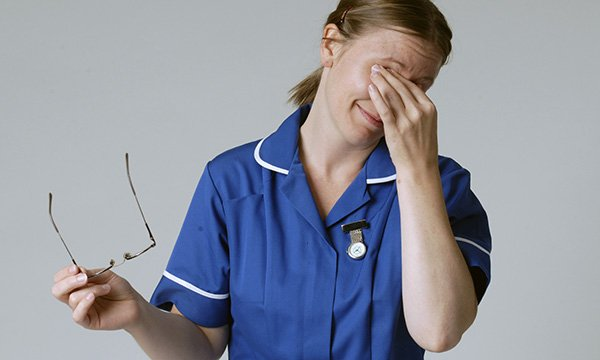 Photograph of tired nurse