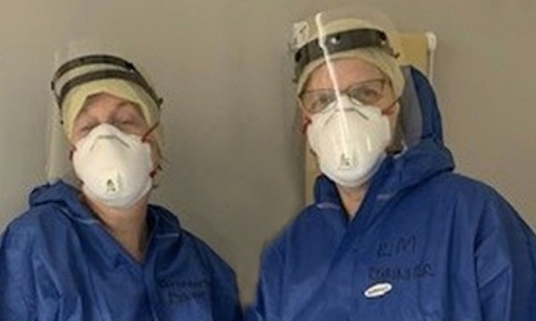 Elizabeth Tysoe and Kim Tolley in PPE