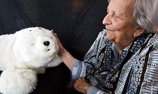 The use of robotic animals in dementia care: challenges and ethical dilemmas